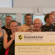 Worthing Community Chest presents a cheque underwater!